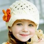 örgü krem turuncu gül motifli çocuk şapkası