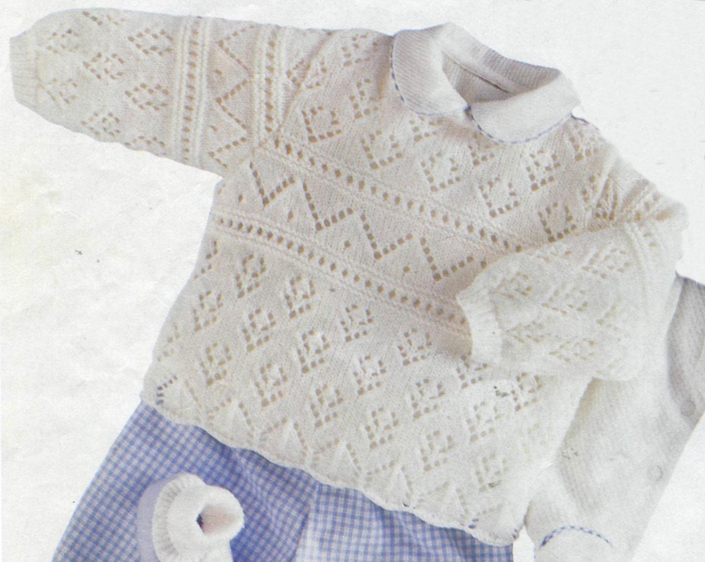 beyaz renkli acur modelli örgü bebek kazağı modeli